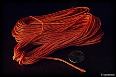 https://flic.kr/p/GhBLEL | 20 meter hank of cord | I bought this imported 20 meter hank of thin diameter orange with reflective tracer tent guy line cordage to try out.  Found on ebay.  I think it's around 1.8mm in diameter.