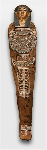 *EGYPT ~ Mummy of Nesmin with mask and other cartonnages. Ptolemaic Period, 305-30 BC; North upper Egypt, Akhmin (khmmis, Panopolis), Maspero 1885-1886...was a priest for the god Min in Akhmim. His father was also a priest + he was named Djedhor. Desmin's mother, a musician for Min called Tadiaset. Nismin's name + that of his father are inscribed on the cartonnages that are on Nesmin's mummy.