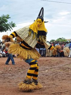 costumes from Ivory Coast - Explore the World with Travel Nerd Nici, one Country at a Time. http://TravelNerdNici.com  man africa dancer