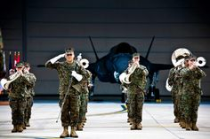 One of the USMC bands play at the roll-out of the first Marine Corps owned F-35Bs