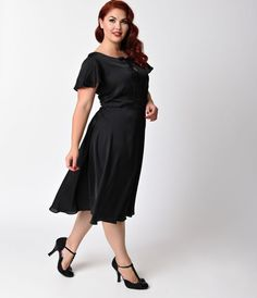 Welcome to the Formosa, darlings. The Plus Size Formosa dress is a pine-worthy 1940s inspired swing in a elegant black, fabulously fresh from Unique Vintage! A feminine satin frock boasting a self tie keyhole neckline met with fluttery cap sleeves and a f