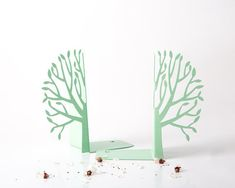 "Minimalistic and stylish bookends - Spring mint edition - These fresh, clean shaped bookends will add an interesting accent to a home of a modern dweller.  Laser cut for precision, strong enough to hold a bunch of favorite books.   One piece measures approximately 7""5 in height and 7"" in widt..."
