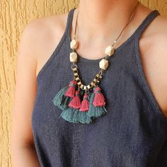 Bold Tassel fringe necklace in Red and Green . Christmas Holiday Jewelry.  Oh what fun tassels can be! Make a statement with this funky tassel necklace. The focal unit of this fringe necklace is made up of numerous emerald green silky tassels and in contrast with this i have incorporated hot pink cotton tassels. The play of different yarns adds a unique texture to this vibrant tassel necklace. This necklace also features large linked box chain in a dull metallic gold finish and four white…