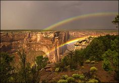 Double rainbows over Canyon de Chelly. I actually got to see one of these. Use to have a picture of it. A third rainbow was faintly and partially forming over the two.