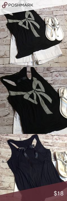 """SZ LG FOREVER 21 BOW TANK TOP Cute black tank top with a racer back and satin bow that ties in the back. Adorable Bow design on the front. Very soft.  Measurements lying flat Armpit to armpit 18.5"""" length 26"""" Forever 21 Tops Tank Tops"""