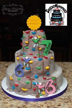 Birthday cake for a set of twin girls and older brother! They all celebrate their birthdays the same month! Party was being held at an indoor rock climbing spot. Buttercream frosting with fondant and gum paste accents....