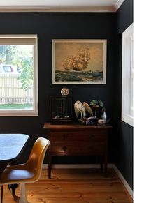 vintage ship painting, dark walls. Tara Pearce dining room via thedesignfiles