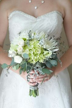 White Spider Mums, White Lisianthus, White Spray Roses, Green Hydrangea, Lace Leaf Dusty Miller & Green Seeded Eucalyptus Bridal Bouquet