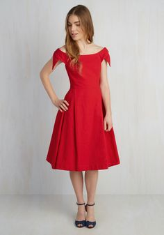 Aglow With Romance Dress. When your sweetheart has a surprise in store for date night, you follow suit by debuting this red midi from hard-to-find British brand Emily and Fin! #modcloth