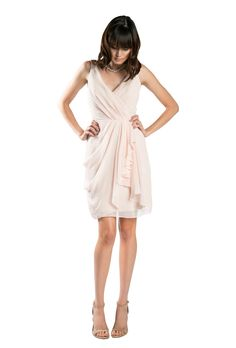 A short, wrap, crinkle chiffon bridesmaid dress with plunging v-neck in four colors. Affordable designer bridesmaid dresses to buy or rent at Vow To Be Chic.
