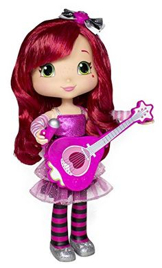 """Strawberry Shortcake 11"""" Singing Doll -Raise her microphone to her mouth for singing and """"shout-outs"""" to the audience Hear her strum the guitar, play some riffs and hum along with the push of a button Sparkly ensemble includes a guitar, microphone, styling comb and a wear & share hair bow.-"""
