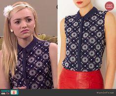 Emma's navy blue floral sleeveless collared top on Jessie.  Outfit Details: http://wornontv.net/41580/ #Jessie