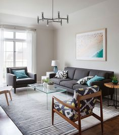 Living Room Of The Contemporary Sna Francisco Home With Plush Couch In Gray And A Variety Chairs Forest Hill Dreary Traditional Turned Into An Airy
