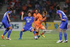 Toshiyuki Takagi (2nd R) of Shimizu S-Pulse and Junya Osaki of Tokushima Voltis compete for the ball during the J. League match between Shimizu S-Pulse and Tokushima Voltis at IAI Stadium Nihondaira on August 9, 2014 in Shizuoka, Japan.
