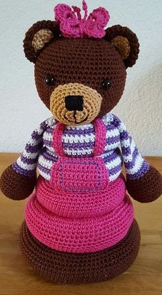 Brown, pink, purple and white colorway of stacking ring bear pattern by Christel Krukkert.