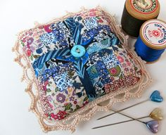 Liberty prints postage stamp pincushion. Look at the minuscule size of those pieces!