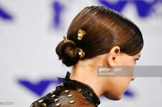 Millie Bobby Brown, hair detail, attends the 2017 MTV Video Music Awards at The Forum on August 27, 2017 in Inglewood, California.