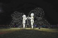 There were thousands of beautiful works of art at this year's Burning Man festival in Nevada, but there's one that really caught people's eyes and invited them to interpret its meaning. 'Love,' by Ukrainian sculptor Alexander Milov, features two wire-frame adults sitting back to back with their inner children reaching out to each other from within. At night, the inner children lit up as well.