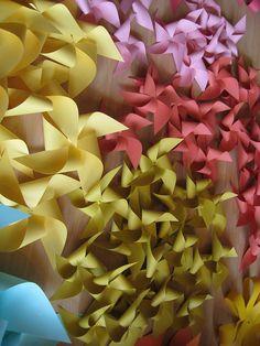 DIY Pinwheel wedding Inspiration:  lots of folding paper pinwheels by jlevindesign, via Flickr