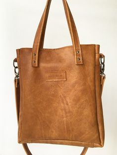 Carry this cognac crossbody bag with the top handles or the detachable shoulder strap. Shopper Bag, Tote Bag, Leather Crossbody Bag, Shoulder Strap, Van, Full Figured, Carry Bag, Tote Bags, Vans