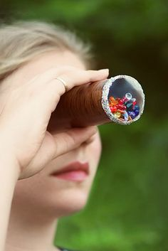 Fill a cardboard tube with reflective paper and beads to make a kaleidoscope.
