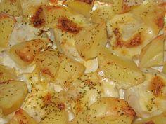 merluza con bechamel y patatas