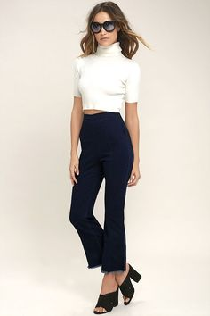 The Michigan Avenue Dark Wash High-Waisted Cropped Flare Jeans are perfect for showing off heels or sneakers! Light and stretchy denim starts at a flattering high waist (with darting), and continues into flaring pant legs, with cropped, back-stitched hems. Antiqued gold side zipper.