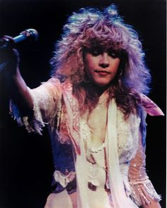 Stevie onstage during'The Wild Heart' tour, 1983  ~ ☆♥❤♥☆ ~   she looks quites messed up here but her beauty and stage presence is still there