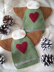 Angels. These would make cute pot holders for the holidays. or wash clothes for doing the dishes ~!~