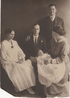 An unknown family. I found this photo in a junk shop and was so consumed with questions about it; I bought it. Who are these people?