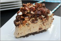 A light and fluffy milk chocolate cheesecake, with a chocolate crust, topped with a chocolate fudge frosting with marshmallows and pecans; a twist on your classic Mississippi Mud Pie.