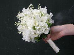 white freesia, sweet pea and lily of the valley bouquet