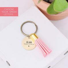 "Custom engraved with your sorority Greek letters, this ""Class of 2020"" suede tassel keychain makes the cutest grad gift for graduating sisters. Shop all tassel colors and engraved designs at www.alistgreek.com! #grad #gradgifts #sororitygrad #collegegraduation #graduationgifts #graduation #gifts #keychain #tassel #custom #personalized #greekletter #aphi #kkg #kappa #tridelta #deltagamma"