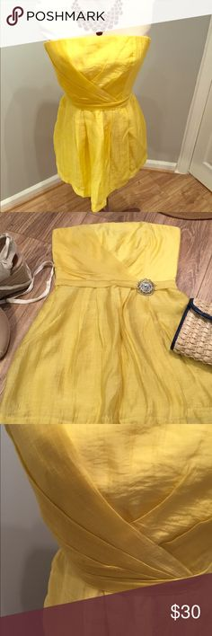 NWT yellow  boutique dress size S NWT Rubber Ducky productions boutique dress size S.  Purchased in the LA Fashion District and it was too small.  Strapless style with back zipper and eye hook closure.  Removable silver brooch at waist. 74% tencel and 26% nylon. Rubber Ducky Productions Dresses Mini