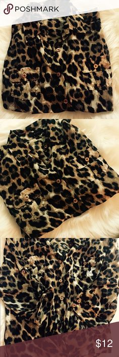 SHEER LEOPARD BLOUSE Gently worn classy leopard button down. Sleeves are adjustable and can be rolled up or down. The front has a cute tie at the bottom and back has cinched detail giving it a nice fit. Depending on your height the front may be slightly cropped on you. NO RIPS/STAINS ❌trades ❌ PayPal ❌ holds 👍 offers*** Please use the offer button ☝🏼 keep in mind PM Takes 20% commission 📦 fast shipper 🛍 I wrap all my orders with delight💕 mine Tops Button Down Shirts