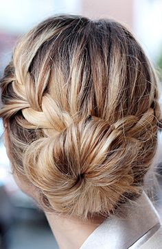 Create two loose french braids on either side of your head, then secure each section with an elastic for a French braided bun. // #Beauty #HairTips