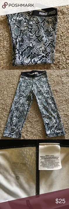 NIKE fit pro never worn workout pants Black and white snake skin workout pants. Silky breathable material. Never worn. Size medium. Nike Pants Capris