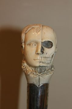 Walking cane with an ivory top half woman/half skull. Period circa 1900