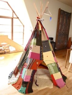 Tifanie of Noddyboom used thrift store found sweaters and textiles for her whimsical teepee style tent.