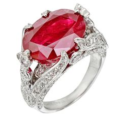 Burmese ruby and diamond ring, centering on an oval-cut Burmese ruby weighing 10.02 carats