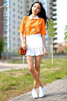 13 Sunny Ways to Wear Orange. Aibina, shot in Astana for Aibina's Blog, via Chictopia