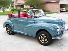 A 1960 Morris Minor, the cream blue with red interior, serious crush. My Mom had one of these when I was a kid, we loved it,  wish I had one now!!