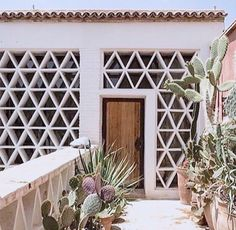 Beautiful white front exterior, front door, mid century modern, MCM, desert, Palm Springs, decorative, architectural, interior design, Hollywood Regency, 1970s, 1960s, white, wood, walkway, Doors, entryway