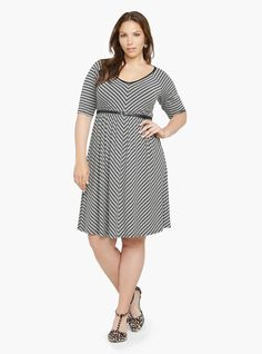 Black and grey mitered stripes add flattering pattern play to this soft knit dress. The flirty silhouette has raglan short sleeves and a V-neckline. Includes a black skinny belt.