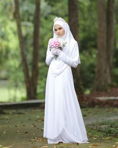 Image may contain: 1 person, wedding and outdoor Muslim Wedding Gown, Hijabi Wedding, Muslimah Wedding Dress, Disney Wedding Dresses, Pakistani Wedding Dresses, Designer Wedding Dresses, Wedding Gowns, Wedding Cakes, Bridal Hijab