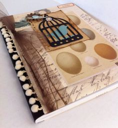 Altered Composition Book. I think Mel will like this one because it is reminescent of 1,000 Gifts. I love ball fringe.