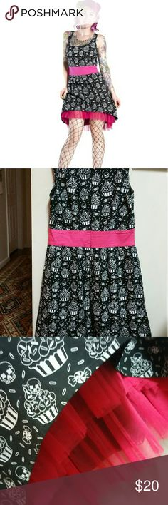Sourpuss Skull Cupcake Dress Let your Goth/Punk girl shine in this awesome dress by Sourpuss. Black dress with a pop of hot pink taffeta peeking from the hem. Skulls adorning cupcakes makes it a fun party dress.   Size Medium   Fit my bust well but a little too big in the waist and I'm too lazy to take it in. My loss is your gain!   ~~EUC~~ Only worn once. Make me an offer. Sourpuss  Dresses