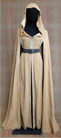 Belted beige cape with hood and floor length sleeves.