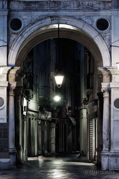 An archway leads to a narrow alley off St. Mark's Square.  Venice, Italy.