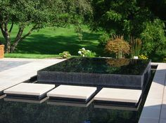 Jacuzzi insert in pool by Apex Landscape, Whitneyville Project